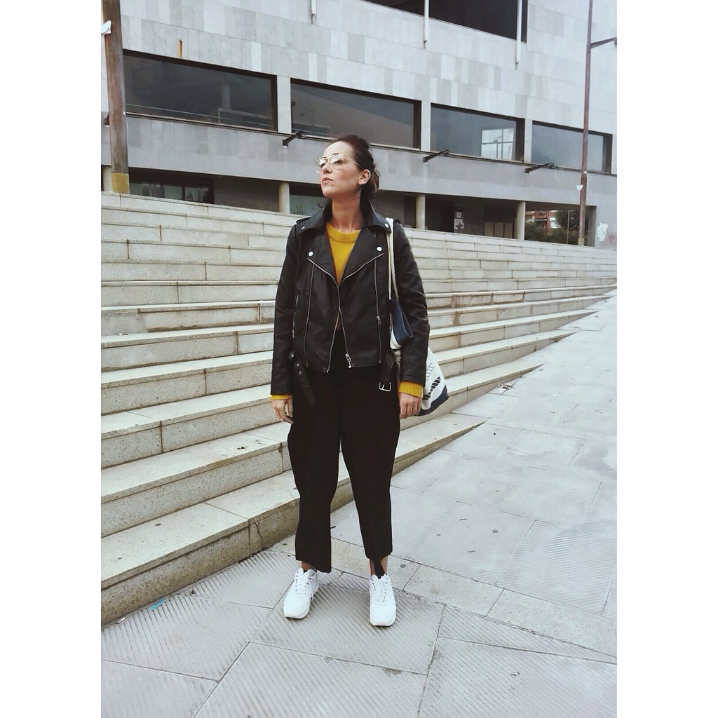comfy and luxury style normcore girl spanish influencer blogger black over size jumpsuit and moustace jersey perfecto jacket